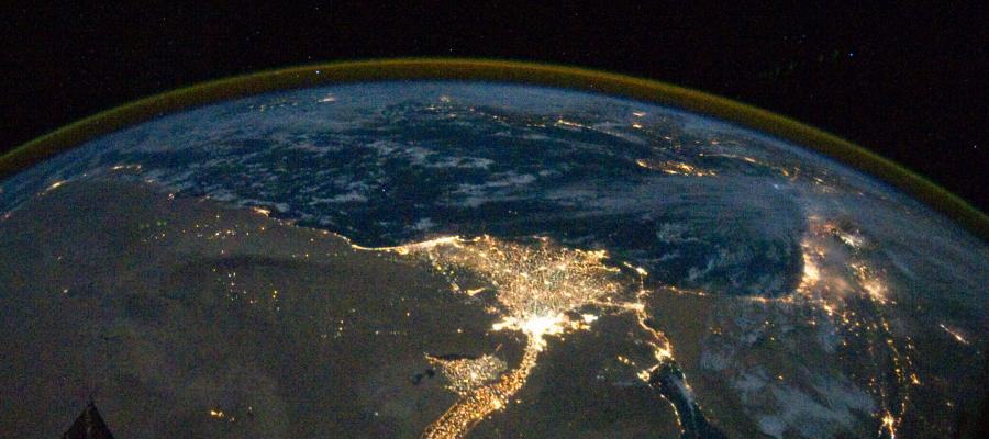 Photograph of the brilliant lights of the Nile river delta at night seen from the International Space Station