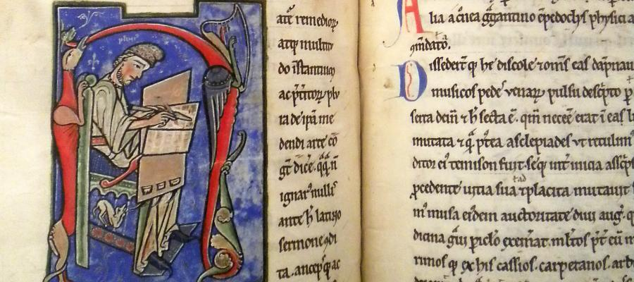 Illuminated manuscript showing a scribe at work copying a manuscript