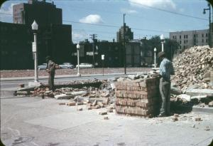 Demolition in Hyde Park for urban renewal, 1957. Saving brick to sell.