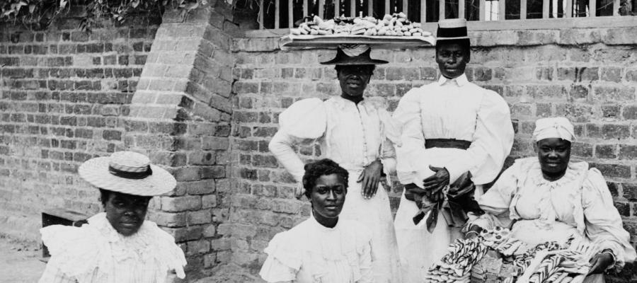 Sweets vendors in Kingston, Jamaica, early 20th century.